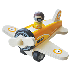 Little toy airplane with girl pilot